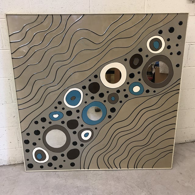 I have a pair of these. They are appear to be from the early 90s. Raised (somewhat 3D) geometric lines and circles with...