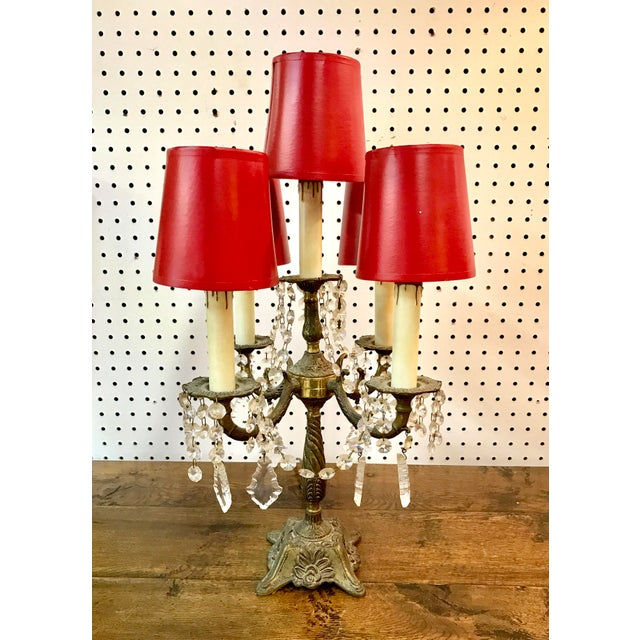 Vintage table top five arm chandelier in the French Empire taste. The electrified table light ships with the included red...