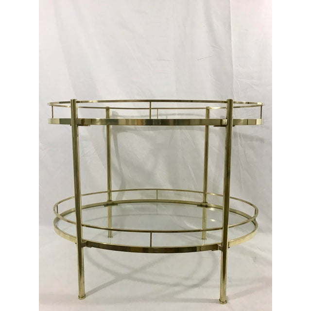 I'm like a crow, I love shiny things, and this highly polished solid and heavy brass table that could be used for a...