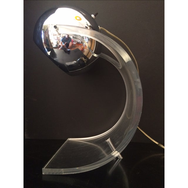 Fabulous lucite and chrome table lamp by Robert Sonneman. This lamp could be used as a desk or accent lamp. It has thick...
