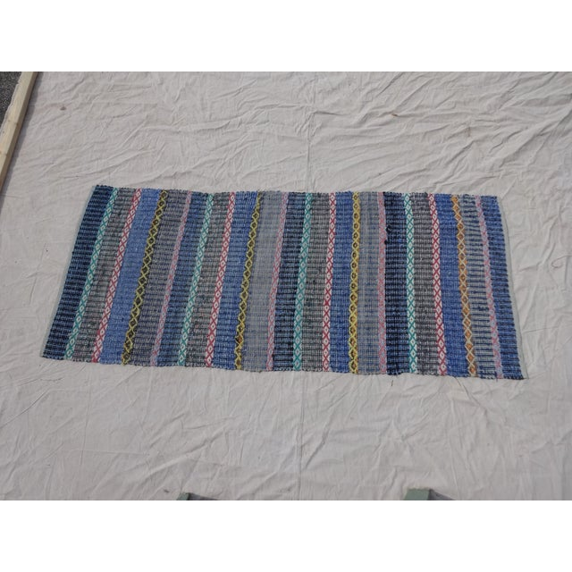 This is an antique, hand-woven, oval-shaped, Swedish rag rug.