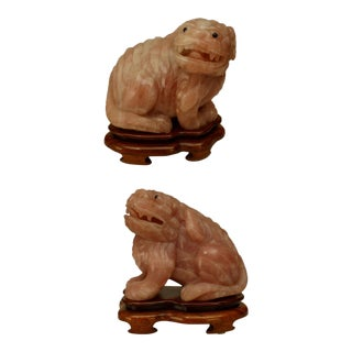 Asian Chinese Rose Quartz Foo Dogs With Black Eyes Seated on Teak Bases- a Pair For Sale