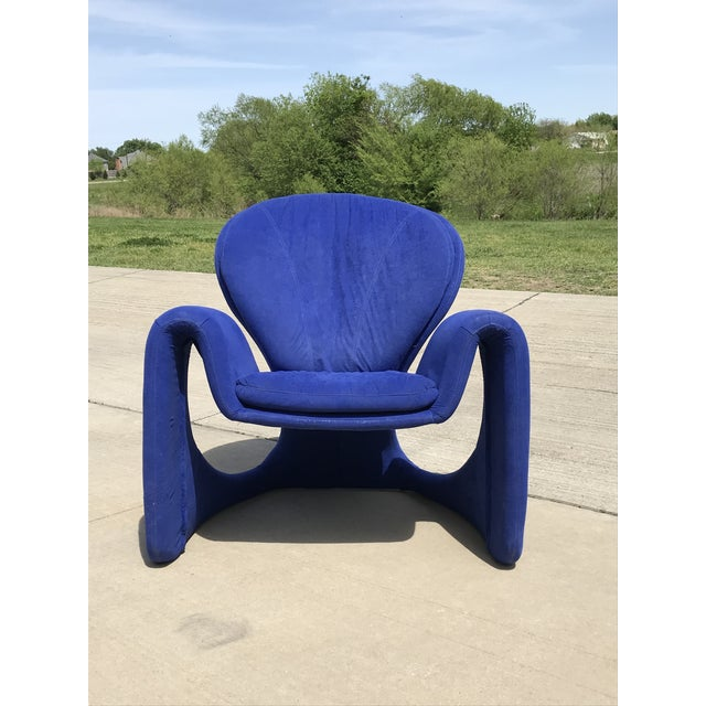 This cobalt blue curvy arm chair in the manner of Olivier Mourgue and Vittorio Introini.