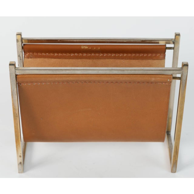 Delvaux Paris desk set comprising of a leather and brass letter rack and a leather note pad with original paper refill...