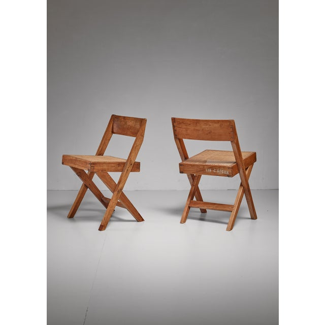 A pair of library chairs from the Chandigarh High Court, India. The chairs were designed by Pierre Jeanneret and made of...
