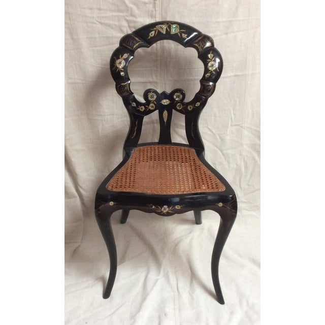 Beautiful petite Italian slipper chair with Caned seat bottom and highy lacquered and painted with flowers with mother of...