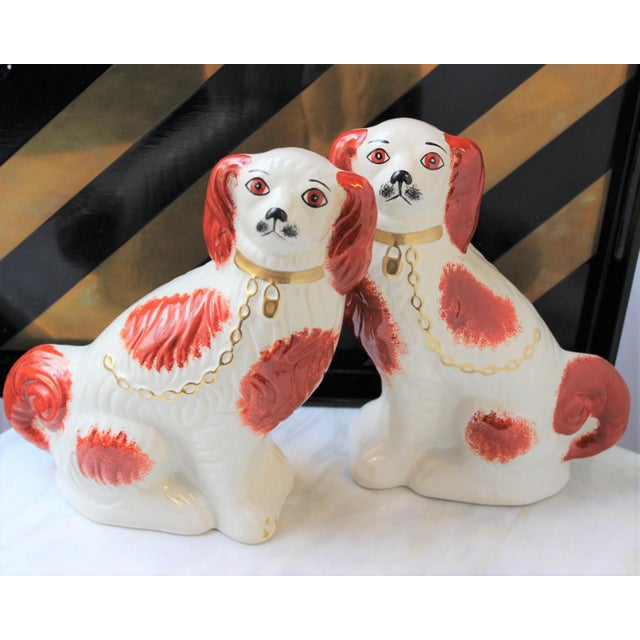 Pair of Vintage Staffordshire Spaniels Dogs in Ceramic. Vintage reproduction. This whimsical pair of Staffordshire...