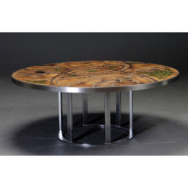 Circular coffee table by Lilly Just Lichtenberg, Denmark, 1960s. The coffee table has a steel frame and the top is made of...