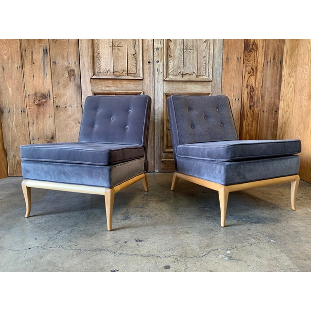 Pair of slipper lounge chairs by T.H. Robsjohn Gibbings. This pair has been upholstered in a blue gray velvet.