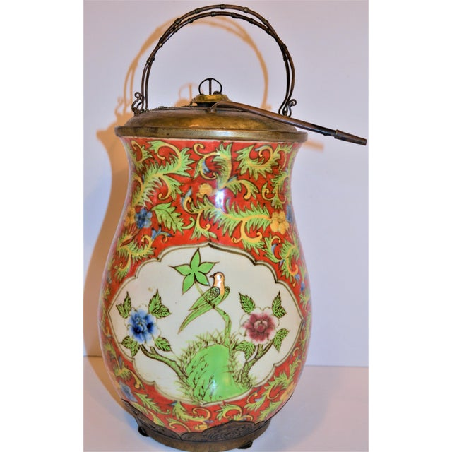 This is a fantastic Chinoiserie red porcelain and brass urn made exclusively for John-Richard Collection, sold in high end...
