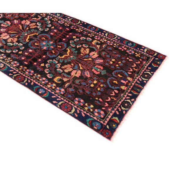 Impressive in style and impeccably woven, this antique Persian Bakhtiari runner with modern style features an all-over...