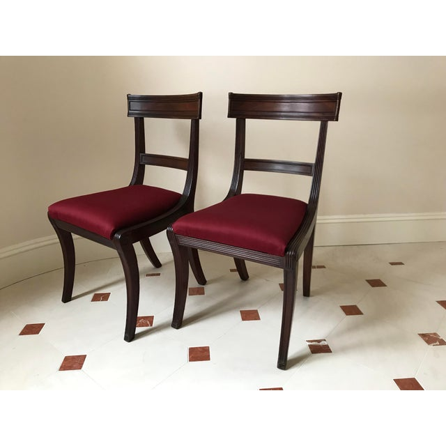 Antique mahogany side chairs. Nice fluting and detail. Seats are removable, burlap basketweave construction firmly...