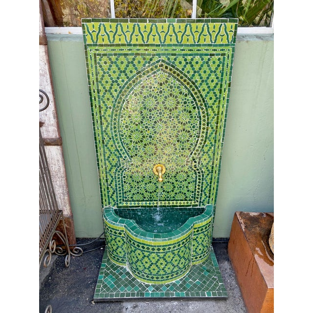 Stunning hand cut and crafted Moroccan arch wall fountain in grand green ceramic tile. Intricate detailed brass faucet....