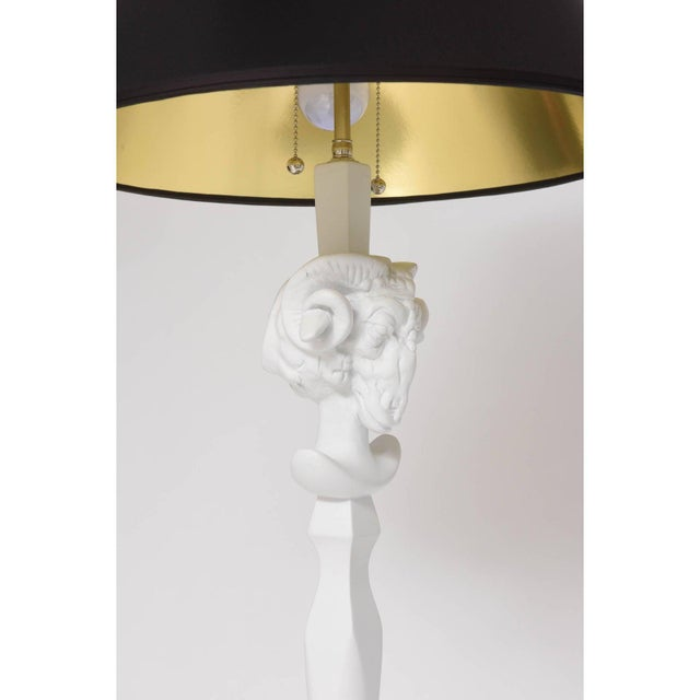 This pair of floor lamps take there inspiration from pieces created by Sirmos with their white plaster-like-finish. The...