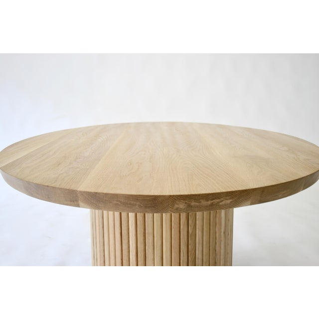 The Audubon pedestal dining table, designed in partnership with interior designer Sherry Shirah combines Scandinavian...