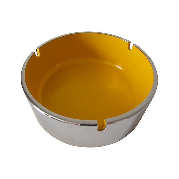 1960s ashtray composed of yellow melamine plastic and chrome. Designed by Isamu Kenmochi for Maru Trend Pacific, Japan.