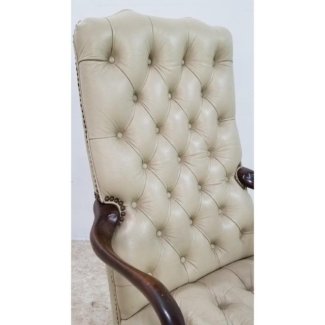Elegant, refined, masculine, strong. All describe this Tan Ivory Tufted Leather Partners Chair. Do you have a library that...