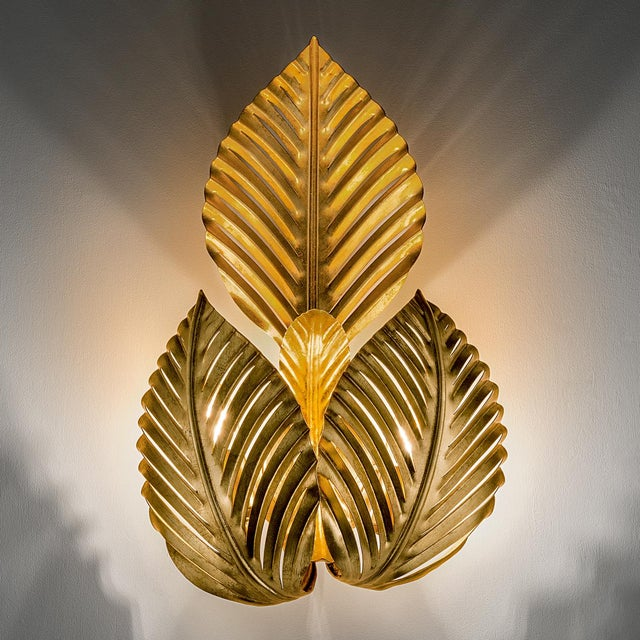 A hand made and decorated palm leaves wall light. Hand plated in florentine antique gold leaf. The palm leaves allow the...