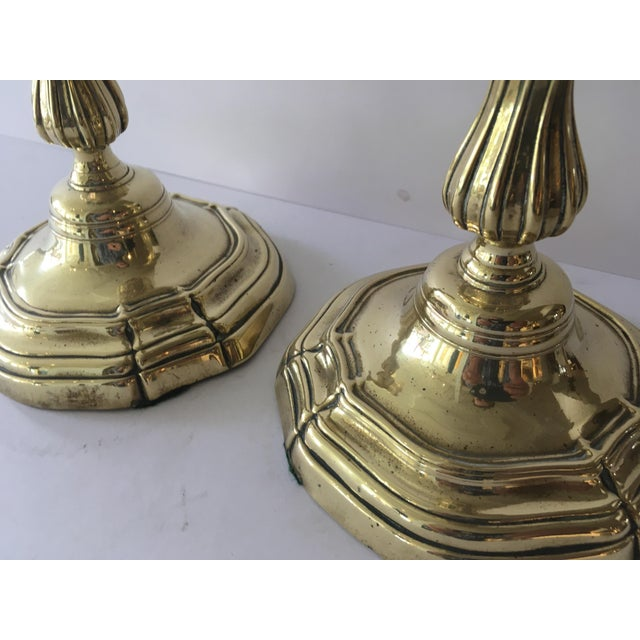 Pair of fine Louis XV highly polished brass candlesticks. Beautifully detailed throughout with a stylized stepped base,...