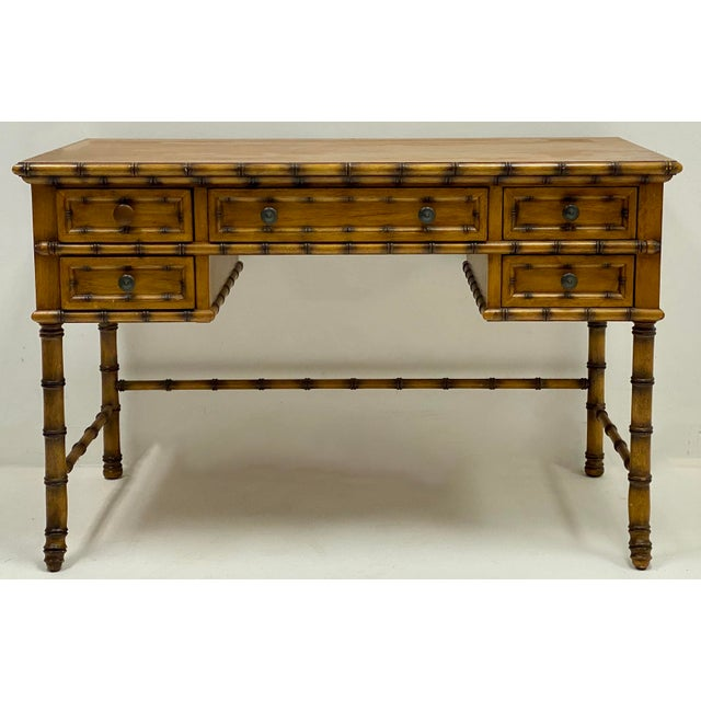 This is a French style faux bamboo desk by Pulaski. It was part of their Roadshow line.