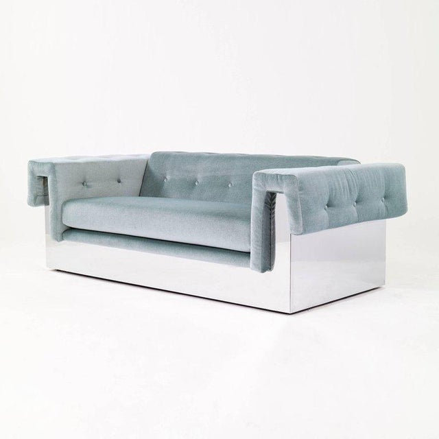 Milo Baughman (1923 - 2003) Modernist pair of stylized button-tufted Chesterfield sofas, raised on polished chrome-clad...