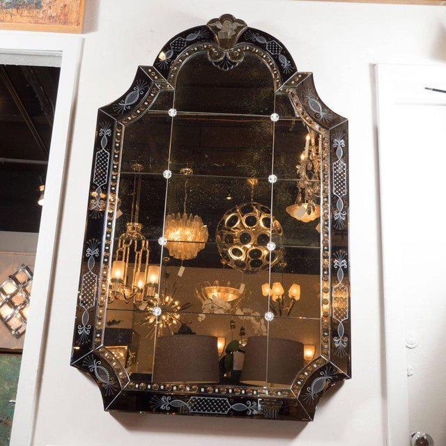 This elegant Hollywood Regency/Art Deco Mirror features a mosaic of twelve rectangular panels and one arched top panel...