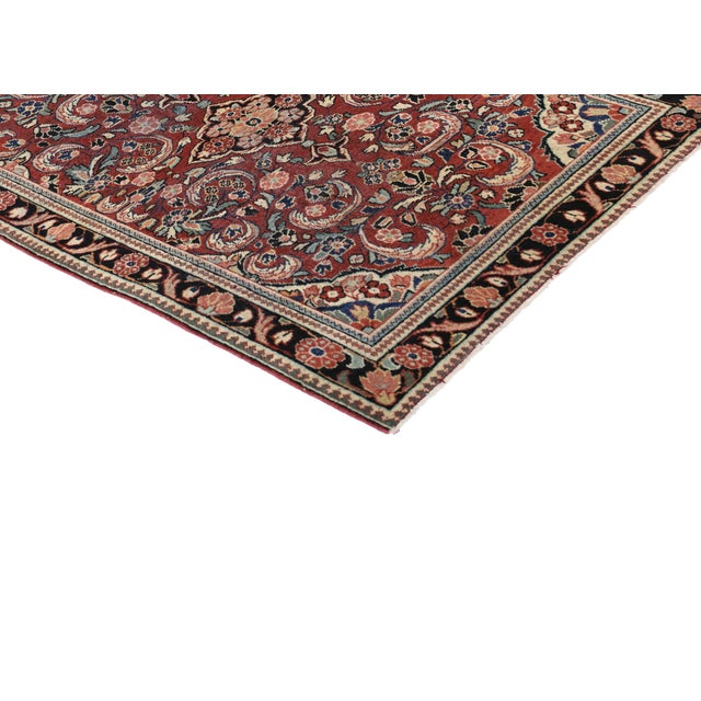 This is a one-of-a-kind vintage Persian Mahal rug made from hand-knotted wool and features an ornate center medallion with...