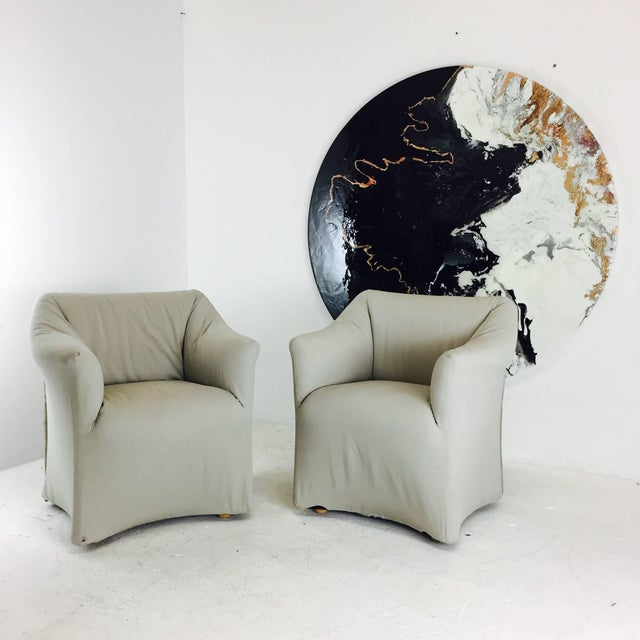 Pair of comfortable Tentazione lounge chairs by Marion Bellini for Cassina. Tailored and sculptural. Upholstery is in good...
