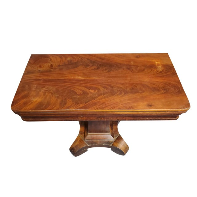 Gorgeous antique table, solid mahogany, top swivels and flips open to square, Pedestal base with scroll feet. Good antique...