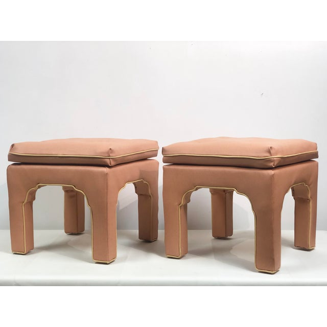 Mid-century or Hollywood Regency vintage set of pink vinyl upholstered ottomans designed by Billy Baldwin circa 1970s.