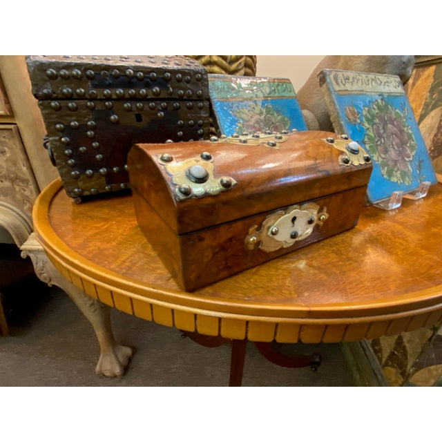 19th century dome top box with ivory and brass cabochons. Blue painted interior.
