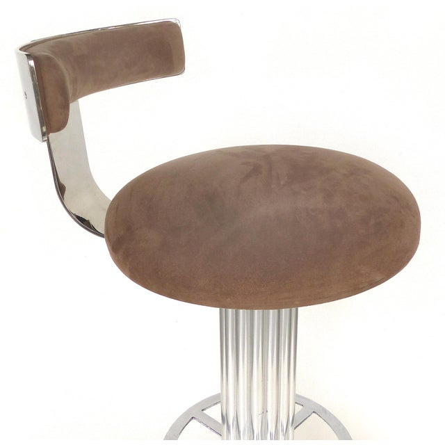 Offered for sale is a set of 3 Designs for Leisure brushed stainless steel bar stools with padded seats and backs...