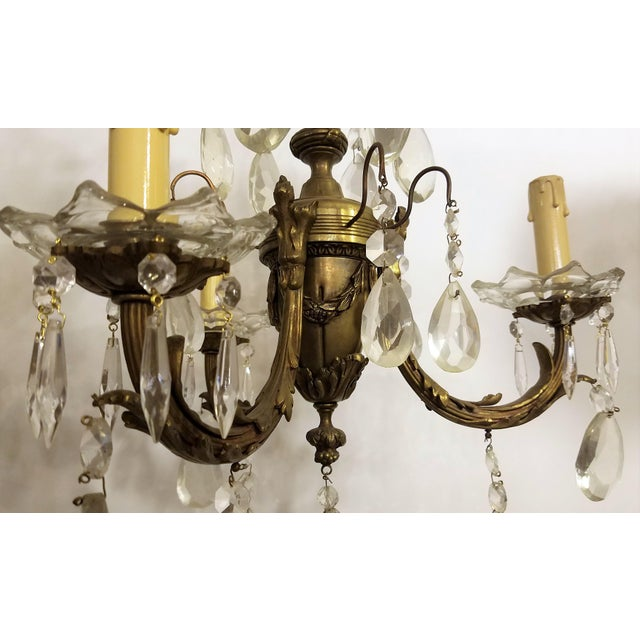 Circa 1910 Empire Style Baroque Bronze & Crystal Chandelier. H= 24 inches, Width= 16 inches. Dimensions do not include...