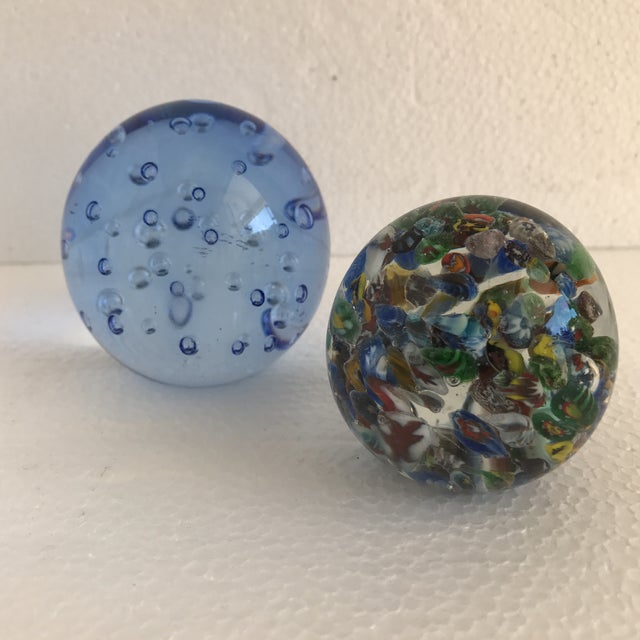 Colorful vintage solid Glass paperweights, set of two. One in a transparent bubble glass blue, and one in the Italian...
