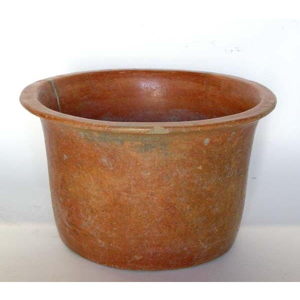 Antique vessel with old repairs. Great patina!