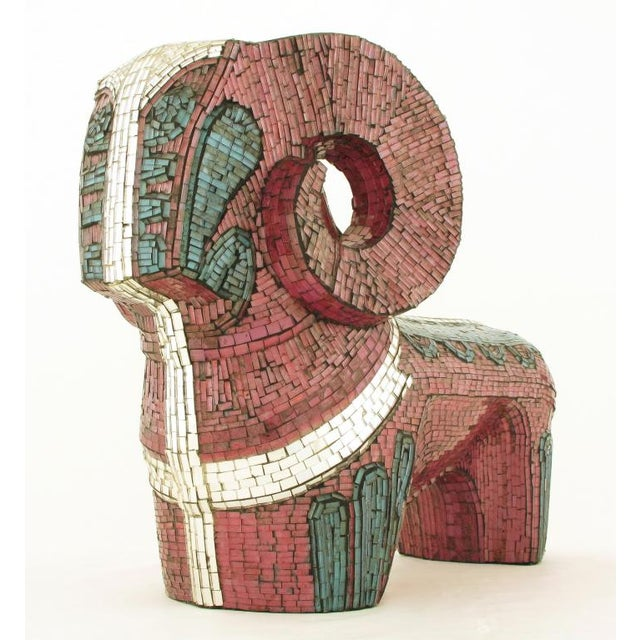 Detailed abstract ram sculpture with thousands of tiny tiles in lavender, turquoise and mirrored glass.