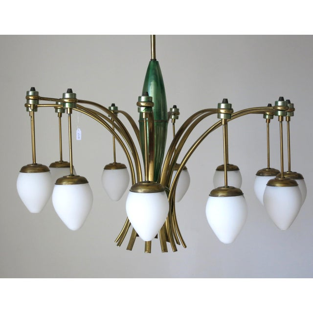 Original vintage chandelier with drop shaped matte white Murano glass and emerald green and brass frame by Stilnovo / Made...