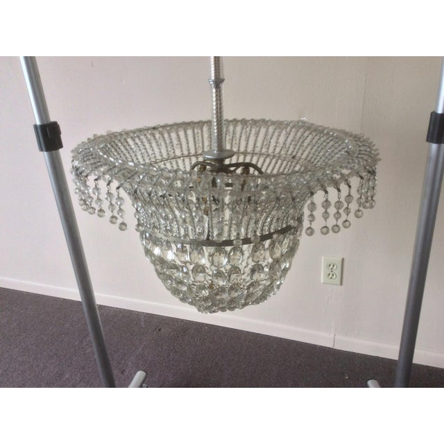 Great looking antique hanging light that can be used as is or made into a flush mount. This was fine glass beads and art...