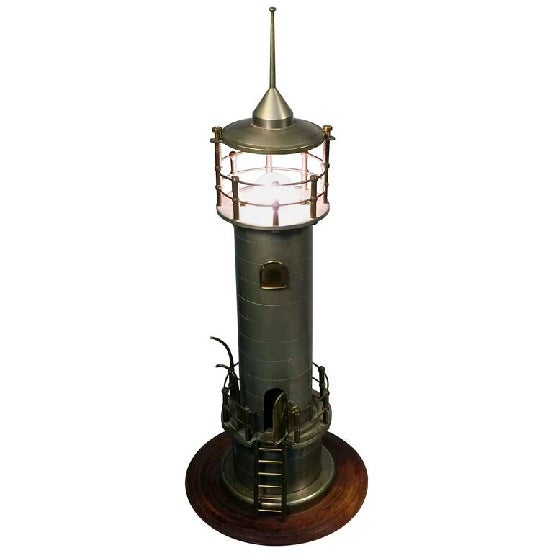 Hand turned aluminium and bronze Art Deco lighthouse lamp with ladder and door that opens and closes. During the 1930s...