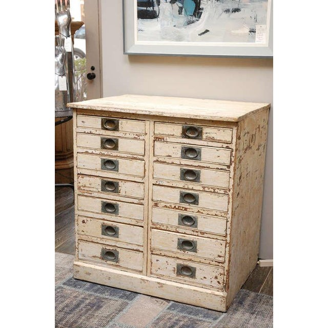 1860s English collector's drawer cabinet chest. 14-drawer painted plinth base chest with brass pulls. Serves as a multi-...