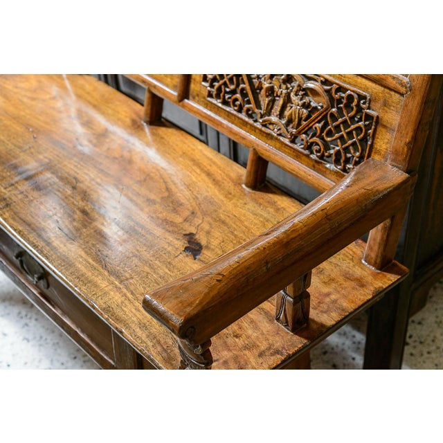 Lovely. Chinese elm wood bench with drawers, fine carving and brass pulls. Late 19th century