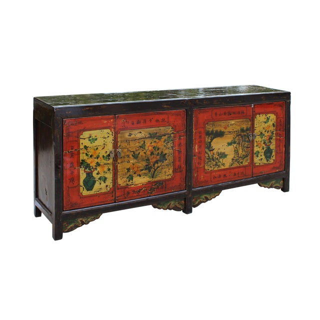 This is a long console sideboard cabinet with oriental hardware as an accent on a simple design and storage doors which...