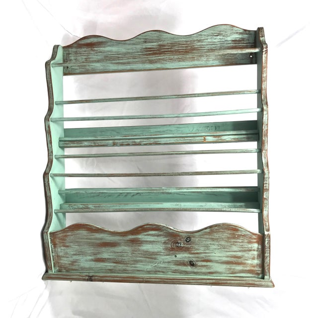 Excellent shabby chic plate rack, hand-painted in a light sea foam color and then distressed over dark-reddish wood. Base...