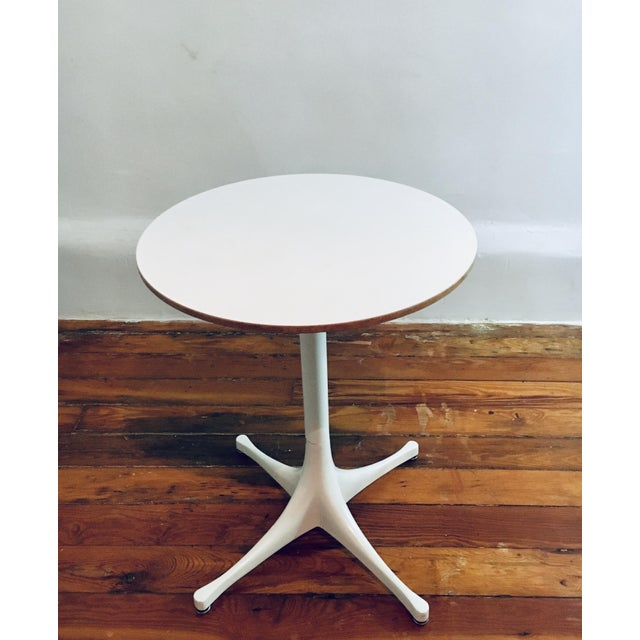 George Nelson & Associates pedestal occasional table by Herman Miller USA, circa 1955. Laminated birch, enameled aluminum...