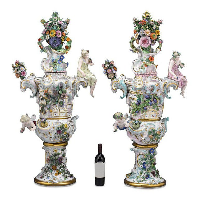 Displaying a level of porcelain artistry unlike anything we have ever seen before, this spectacular pair of Meissen urns...