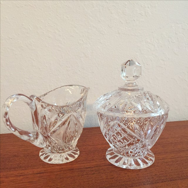 This is a beautiful heavy cut glass cream and sugar set (with lid) in perfect condition. A wonderful addition to your...