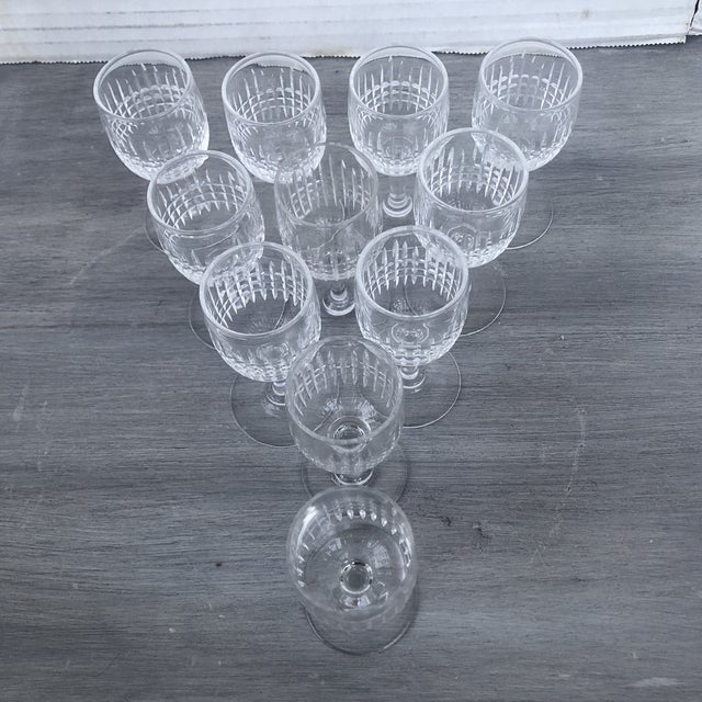 Hand cut set of 11 petite crystal cordial glasses. Perfect for the upcoming holiday season. Elegant hand current design of...