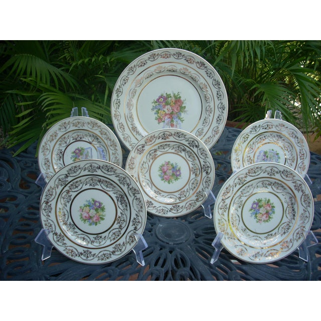 large round cake platter or other dessert items with 5 individual dessert plates in off-white and a classic multi-color...