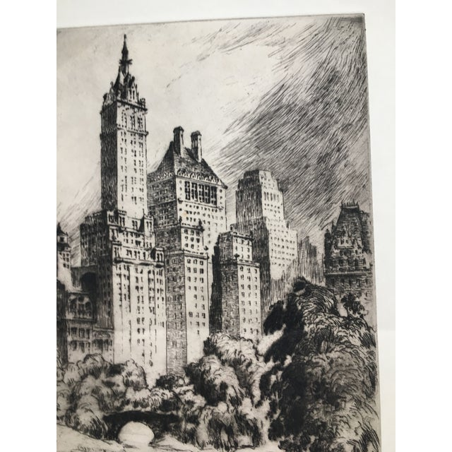 This limited edition original etching, circa late 1940, captures the artist's enchantment with New York City. Central Park...