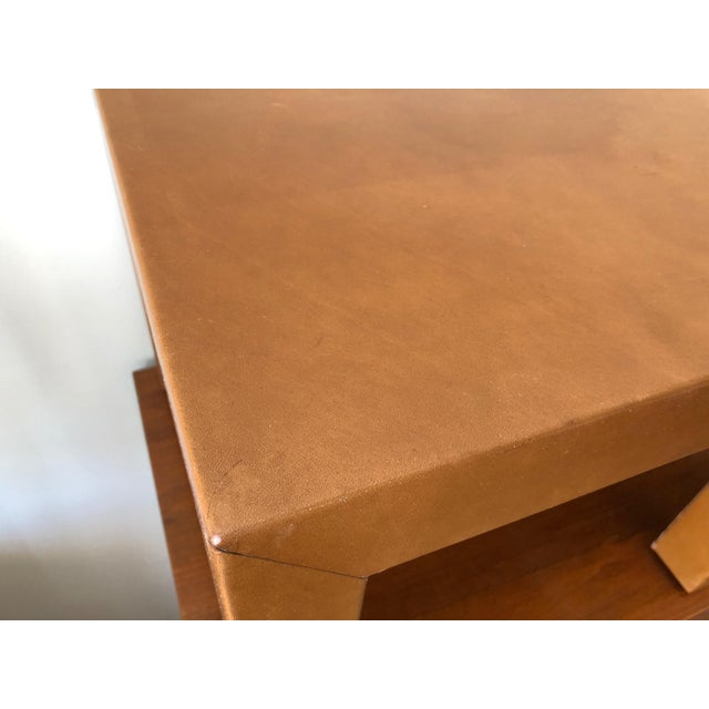 A pair of vintage occasional tables recovered in brown patinated leather.